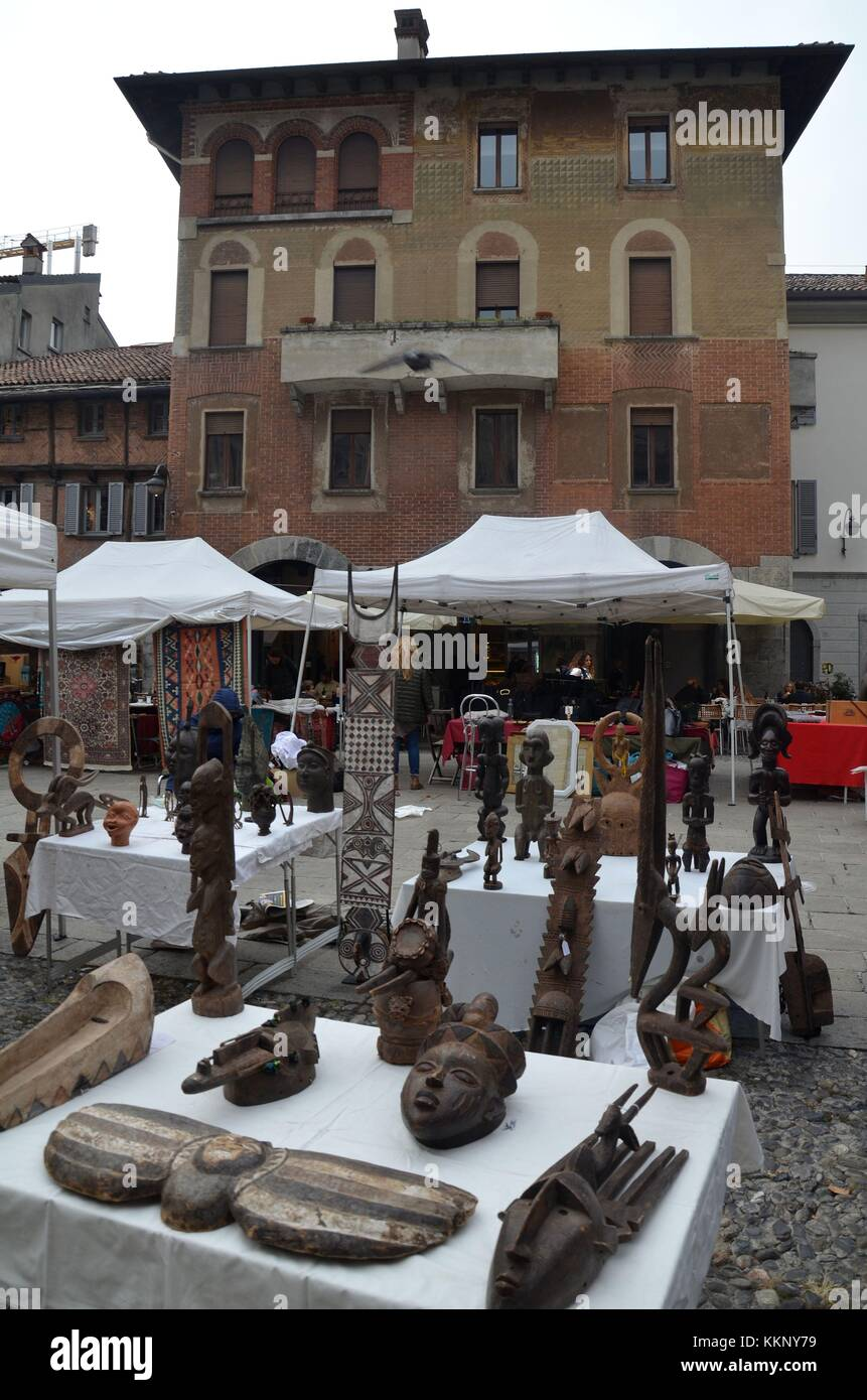 The Italian town of Como at the Swiss border: African art - Stock Image