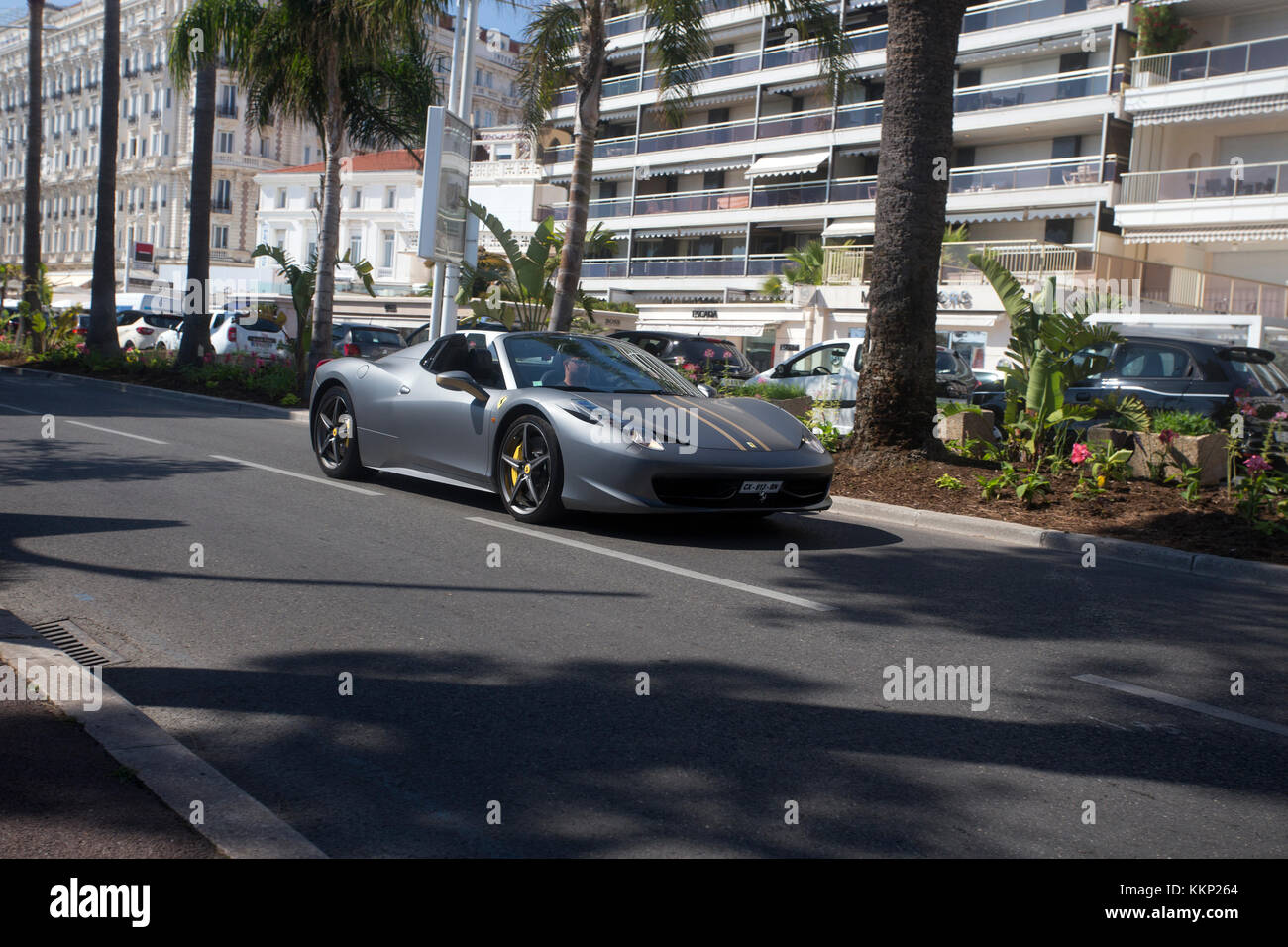 Ferrari 458 italia spider driving along La Croisette in summer, Cannes, France Stock Photo
