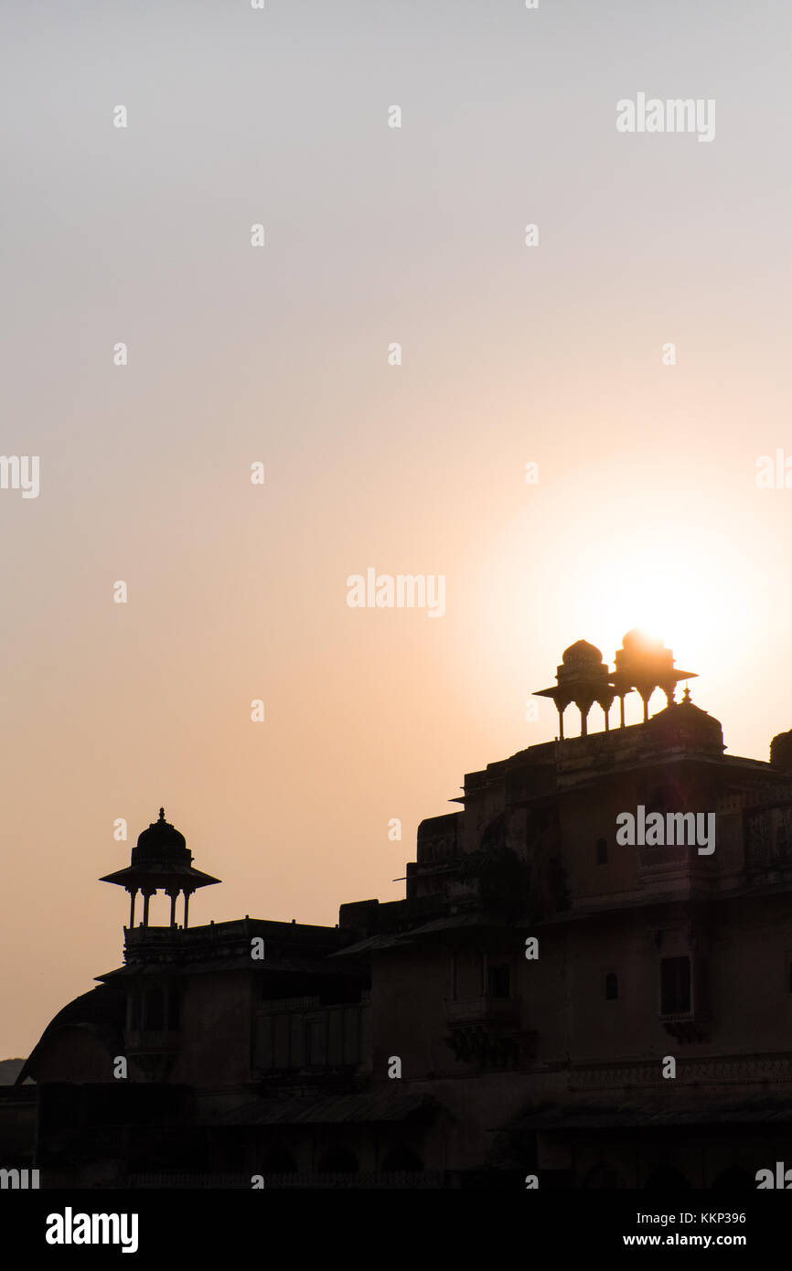 Turrets and cupolas of an Indian Palace aginst a sunset, Bundi, Rajasthan,India - Stock Image