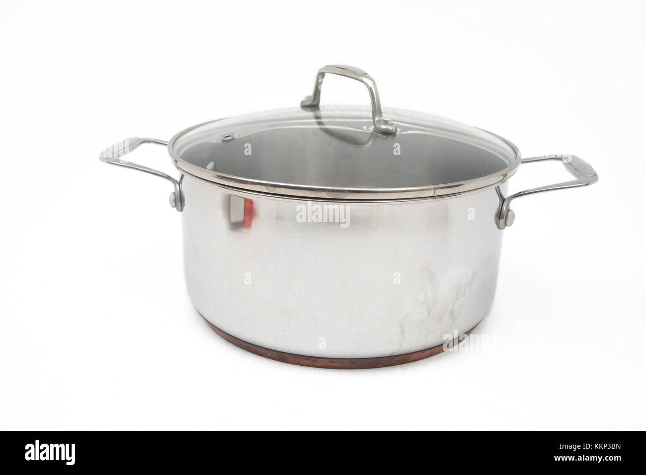 Stainless Steel Copper Bottom Cooking Pot with Glass Lid - Stock Image