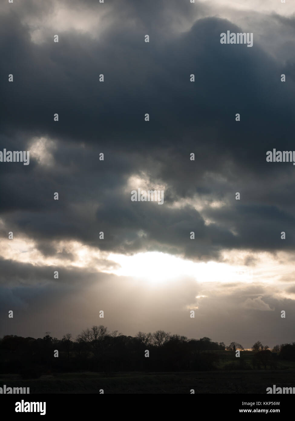 dramatic cloudy sky stormy weather elements above heavens; essex; england; uk Stock Photo