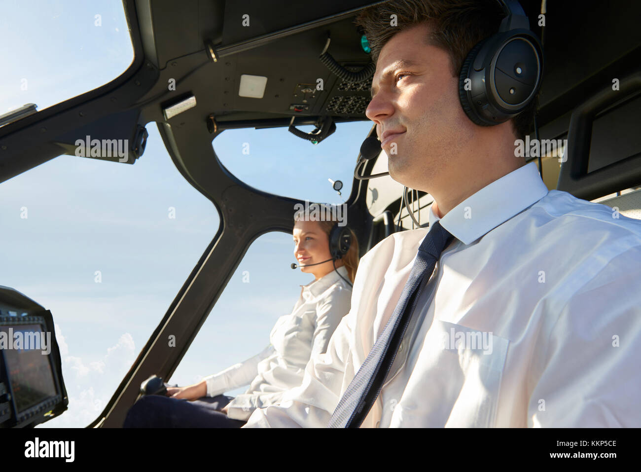 Pilot And Co Pilot In Cockpit Of Helicopter - Stock Image