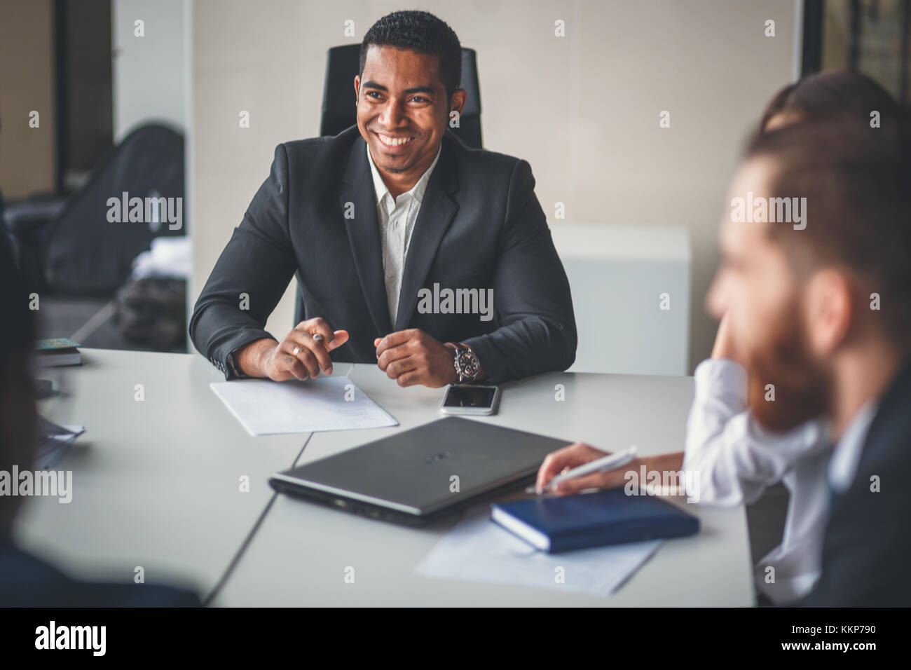 team leader and business owner leading informal in-house business meeting - Stock Image