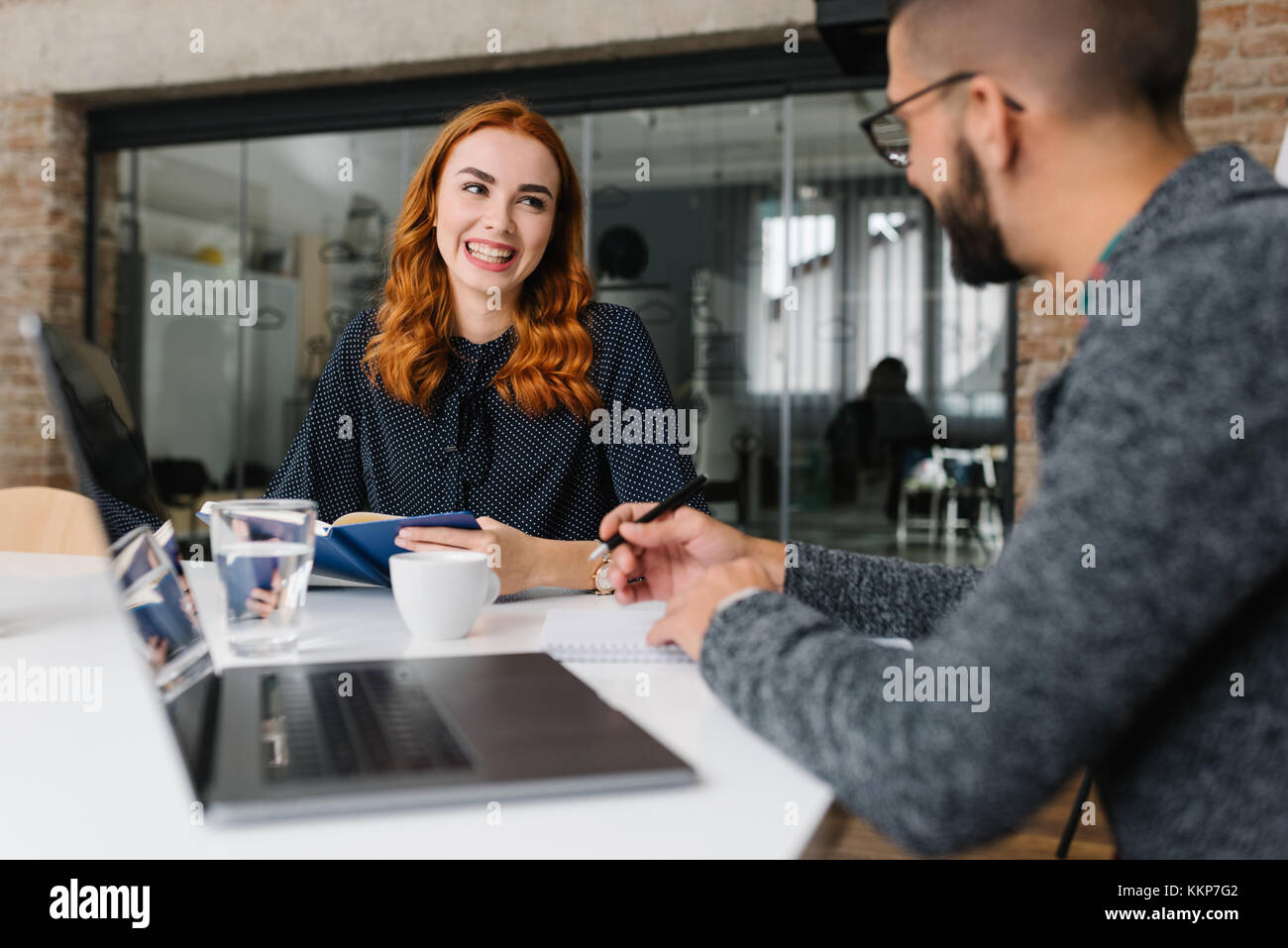 Smiling woman being interviewed by headhunter Stock Photo