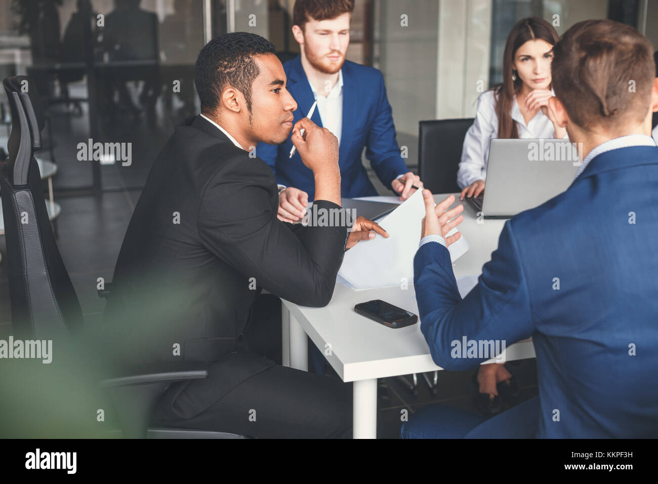 Boss heading a business reunion with partners - Stock Image