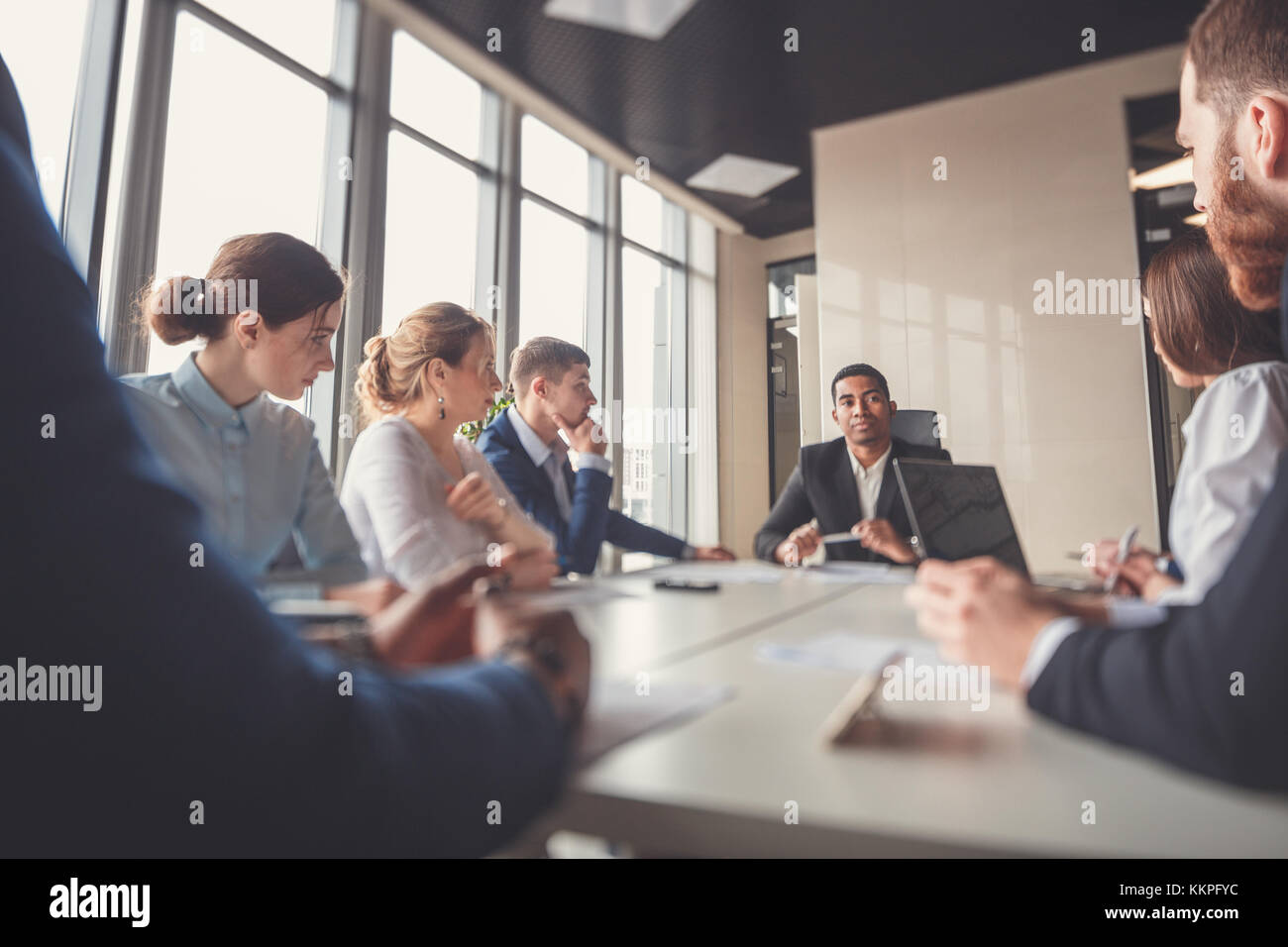 black leader of the business people giving a speech in a conference room. - Stock Image