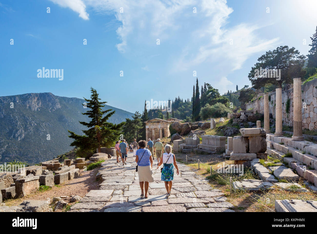 Tourists on a path through Ancient ruins at Delphi, Greece Stock Photo