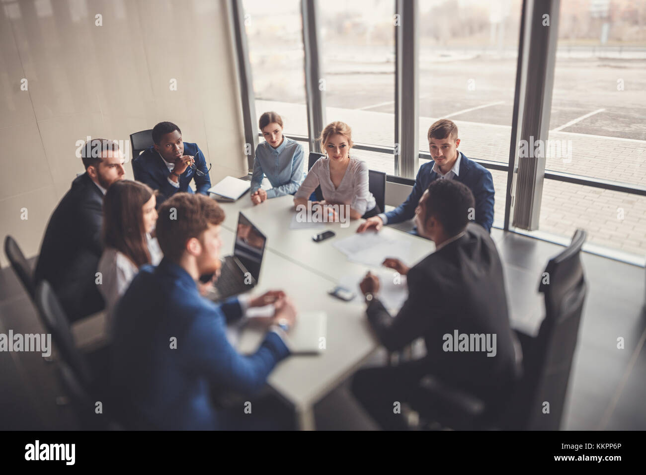 business team and manager in a meeting - Stock Image