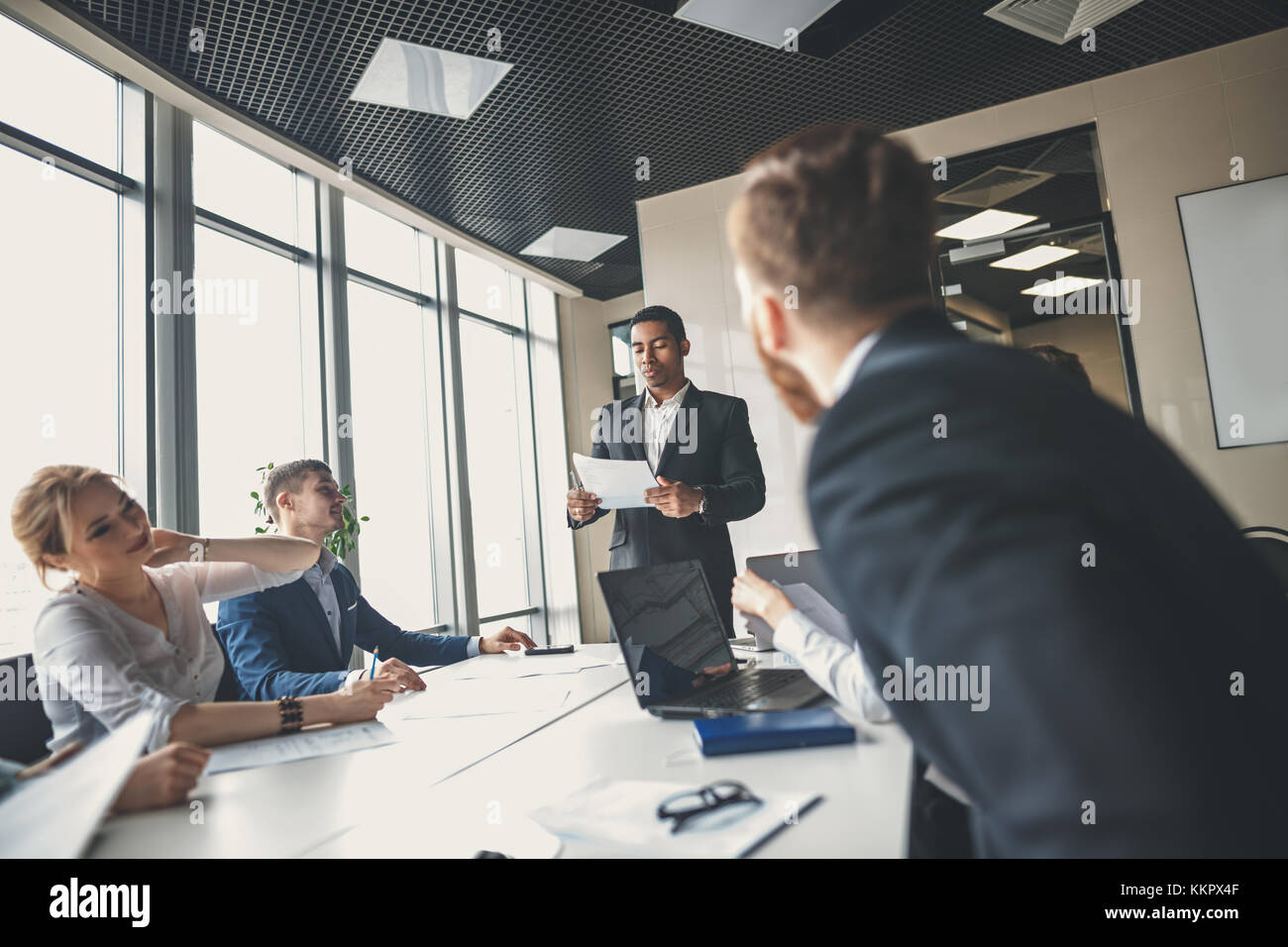 Business people working in modern conference room - Stock Image