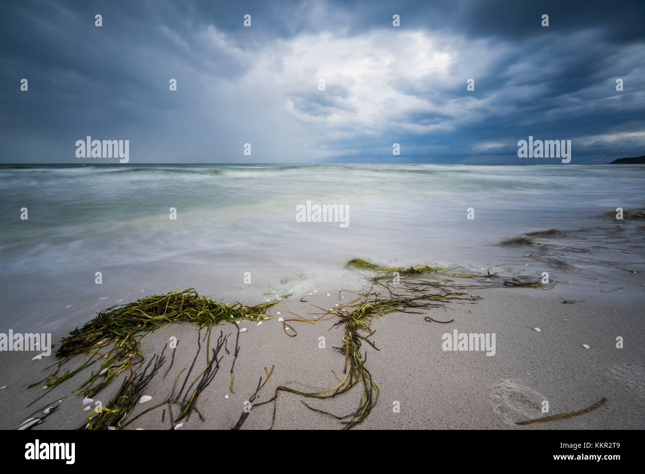 Stormy atmosphere on the Baltic Sea, moving water with whitecaps, long exposure - Stock Image