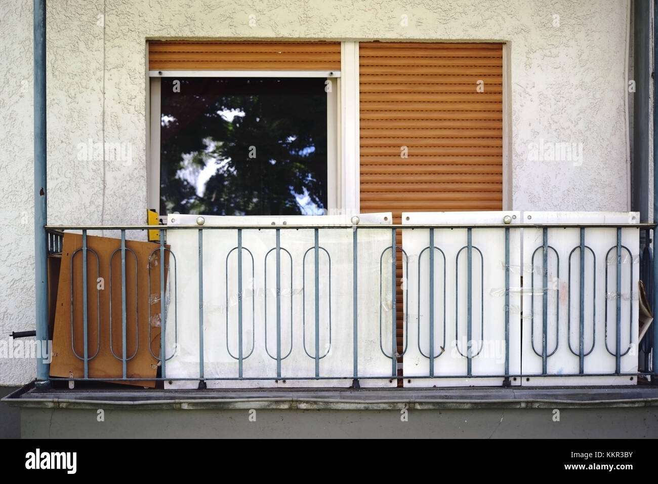 The balcony of a cleared social flat with junk. - Stock Image