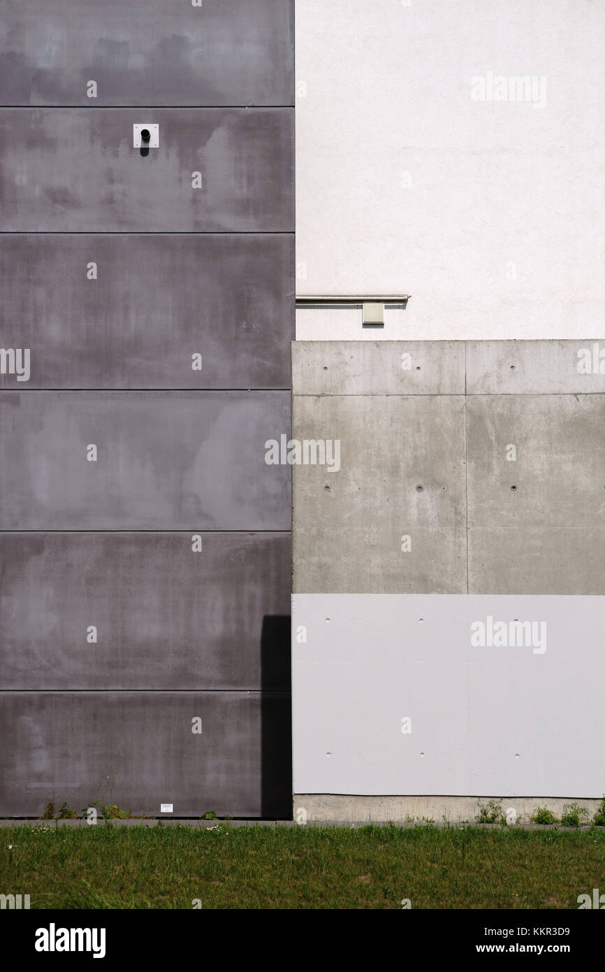 Angular interlaced concrete linings of a facade made of different surfaces and colours. - Stock Image