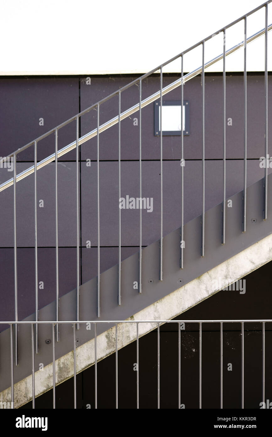 Detail Of Modern Stairs With A Stainless Steel Railing And A Wall Lamp.    Stock