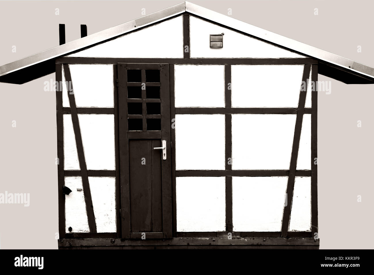 A half-timbered garden shed for storing garden tools and material. Stock Photo