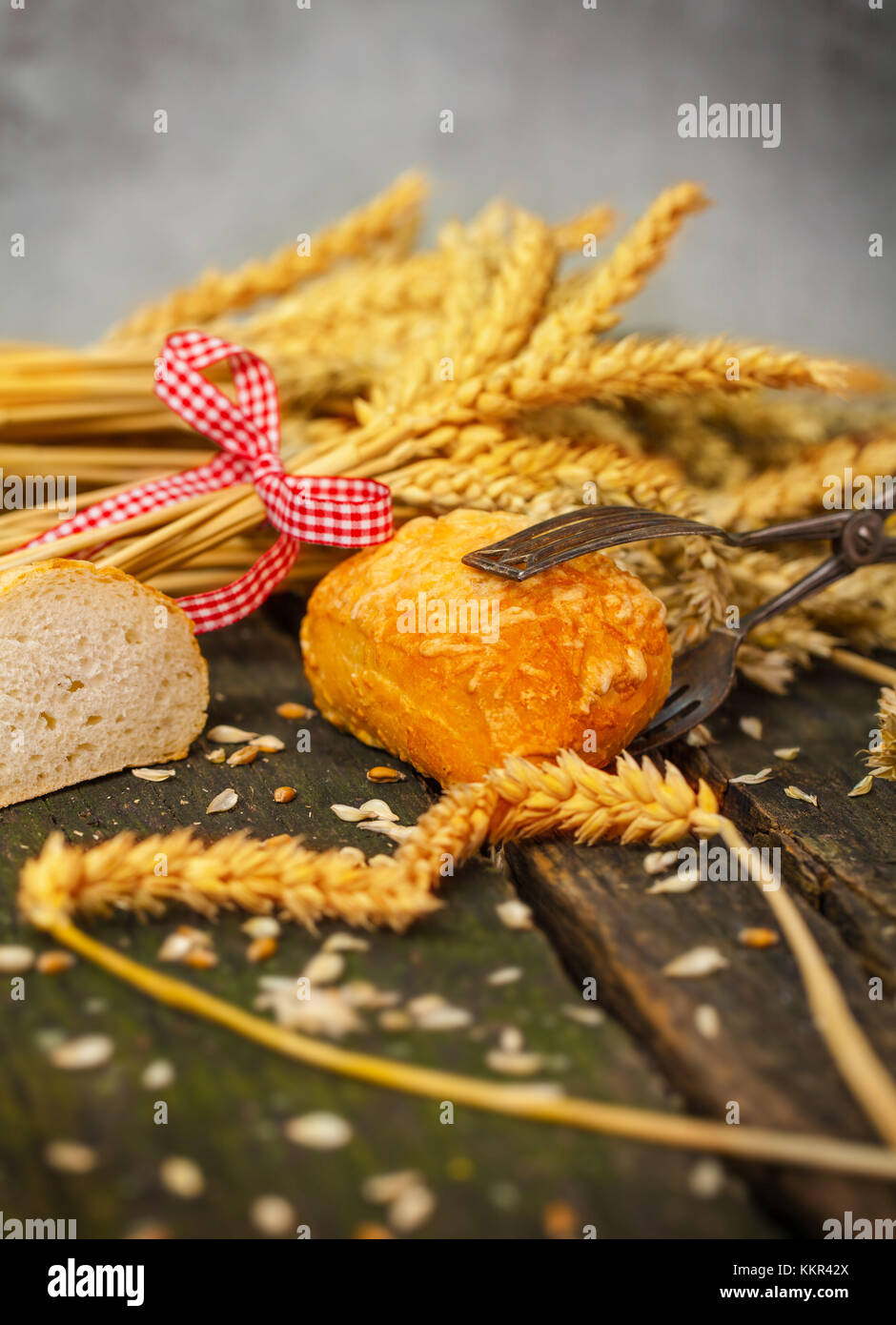 Pastry tongs taking bread roll - Stock Image