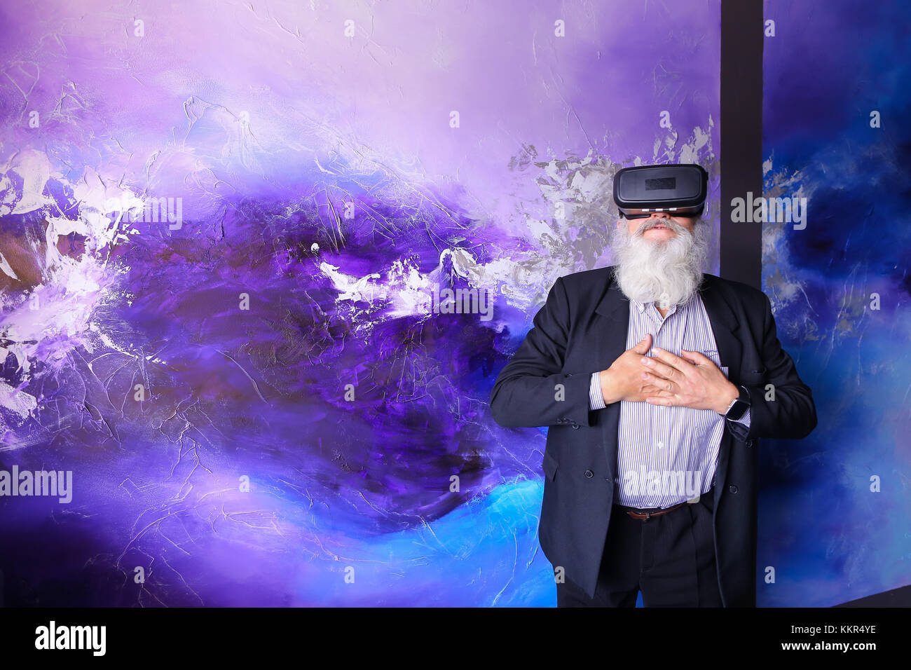 d66151dc813 Elderly man in VR glasses outside imagination felt virtual reality and  enjoys seen and new technologies. Old man with long gray beard of European  appe