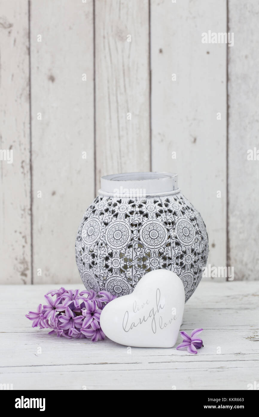 Hyacinth flowers with vase and heart shape, close up, still life Stock Photo