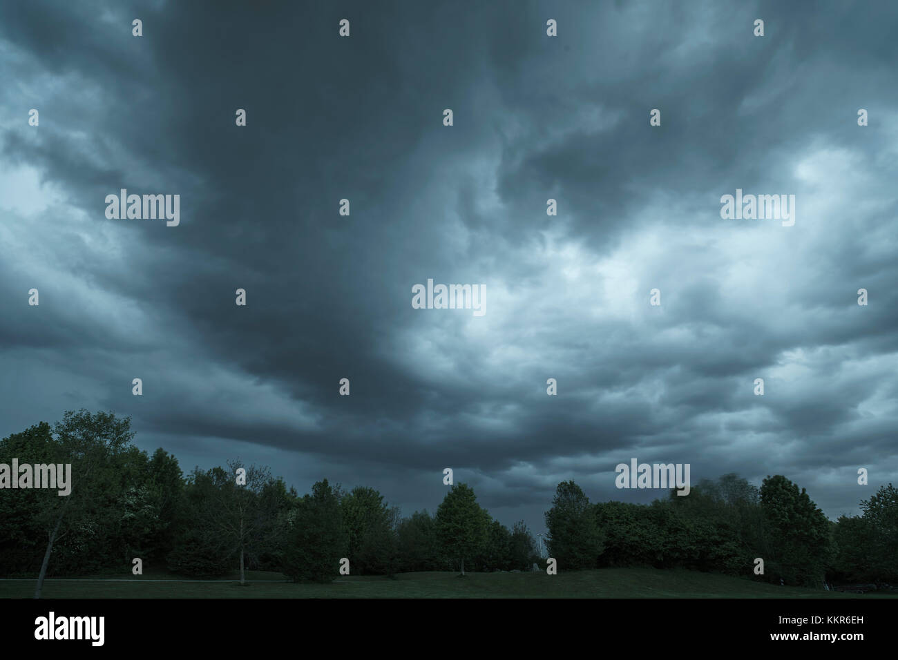 Dark clouds above a park - Stock Image