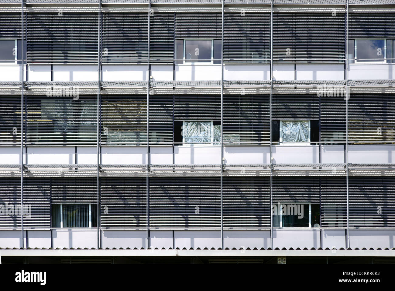 The modern facade of a public building with steel design works the shades throw. - Stock Image