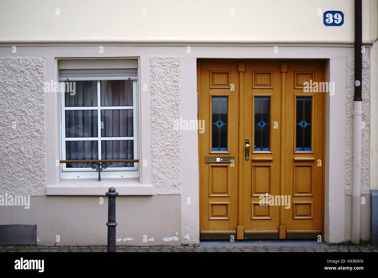 The entrance of an Old Town flat with very low ceilings and a window. Stock Photo