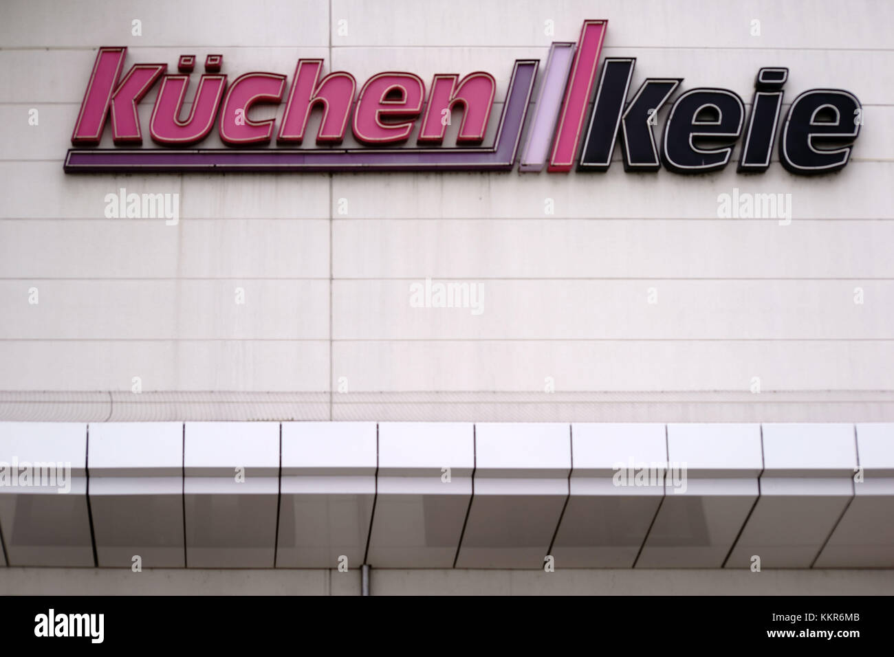 nameplate and logo of the furnishings market for kitchens Küchen Keie on the facade of a building - Stock Image