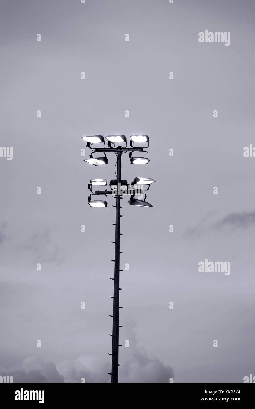 lighted floodlights / headlight for the illumination of a football stadium, - Stock Image