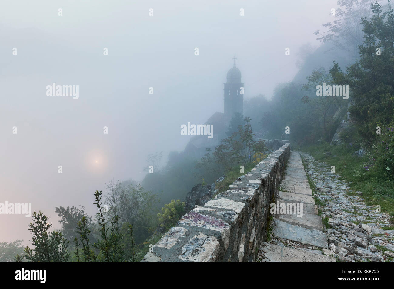 Fortifications of Kotor, part of the Natural and Culturo-Historical Region of Kotor, Montenegro, in a foggy morning - Stock Image