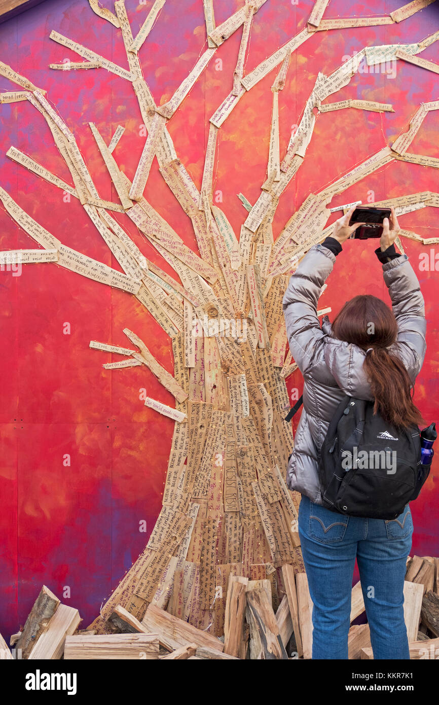 Personal hopes, messages & prayers written on slats of wood for the shape of a tree at the Union Square pre - Stock Image