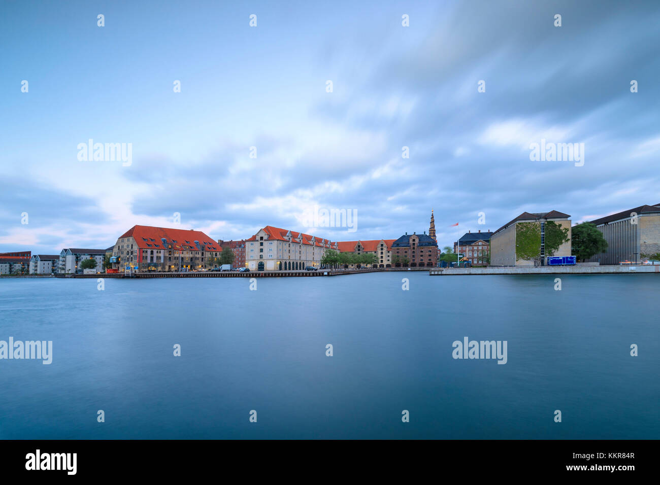 Danish Architecture Centre housed in a restored shipyard warehouse seen from canal of Christianshavn, Copenhagen, - Stock Image