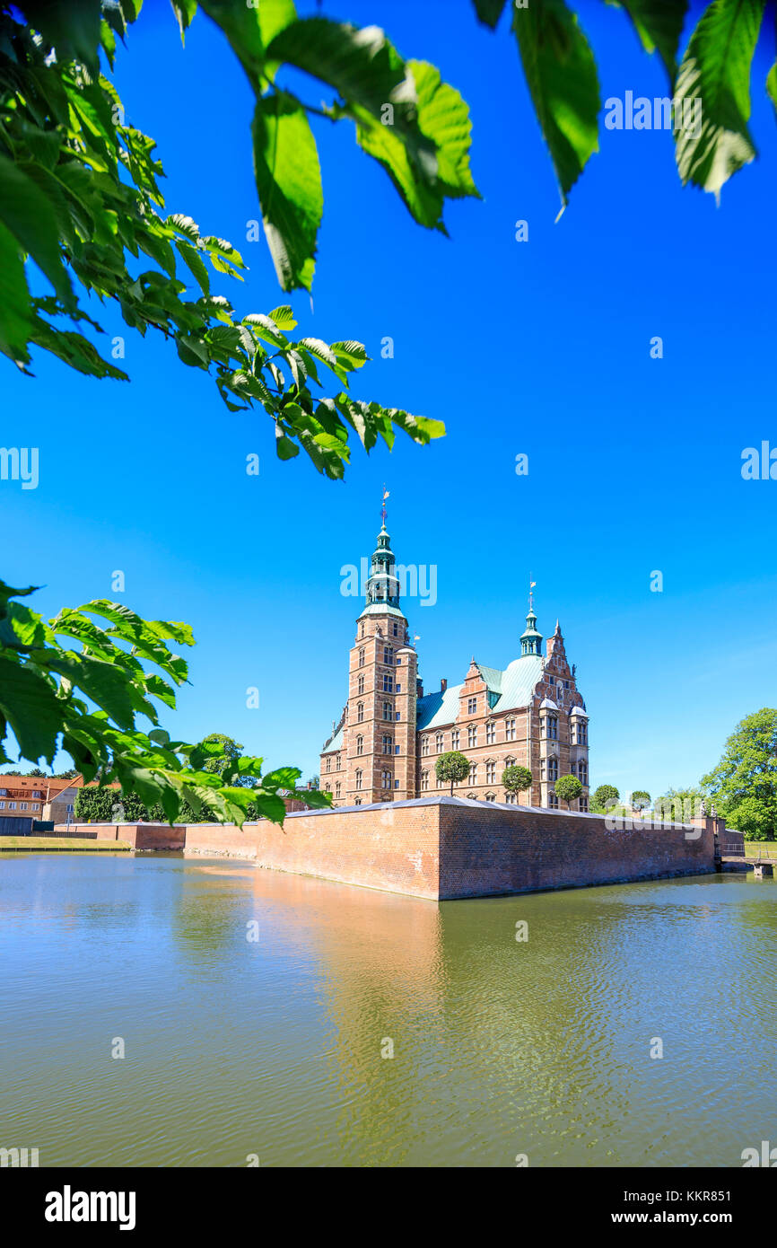 Rosenborg Castle built in the Dutch Renaissance style seen from the banks of canal, Copenhagen, Denmark - Stock Image