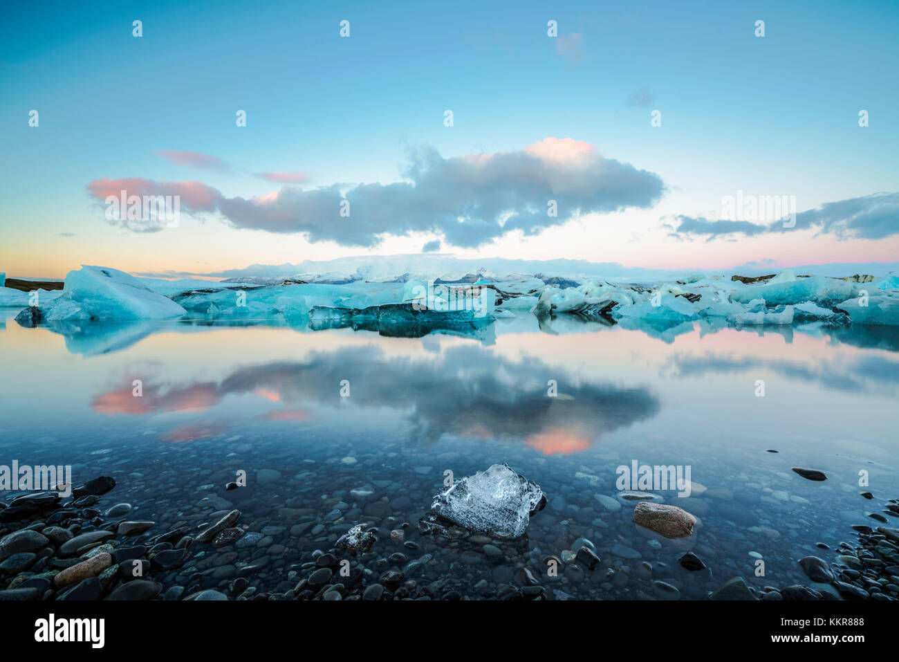 Jokulsarlon, Eastern Iceland, Iceland, Northern Europe. The iconic little icebergs lined in the glacier lagoon during a sunrise Stock Photo
