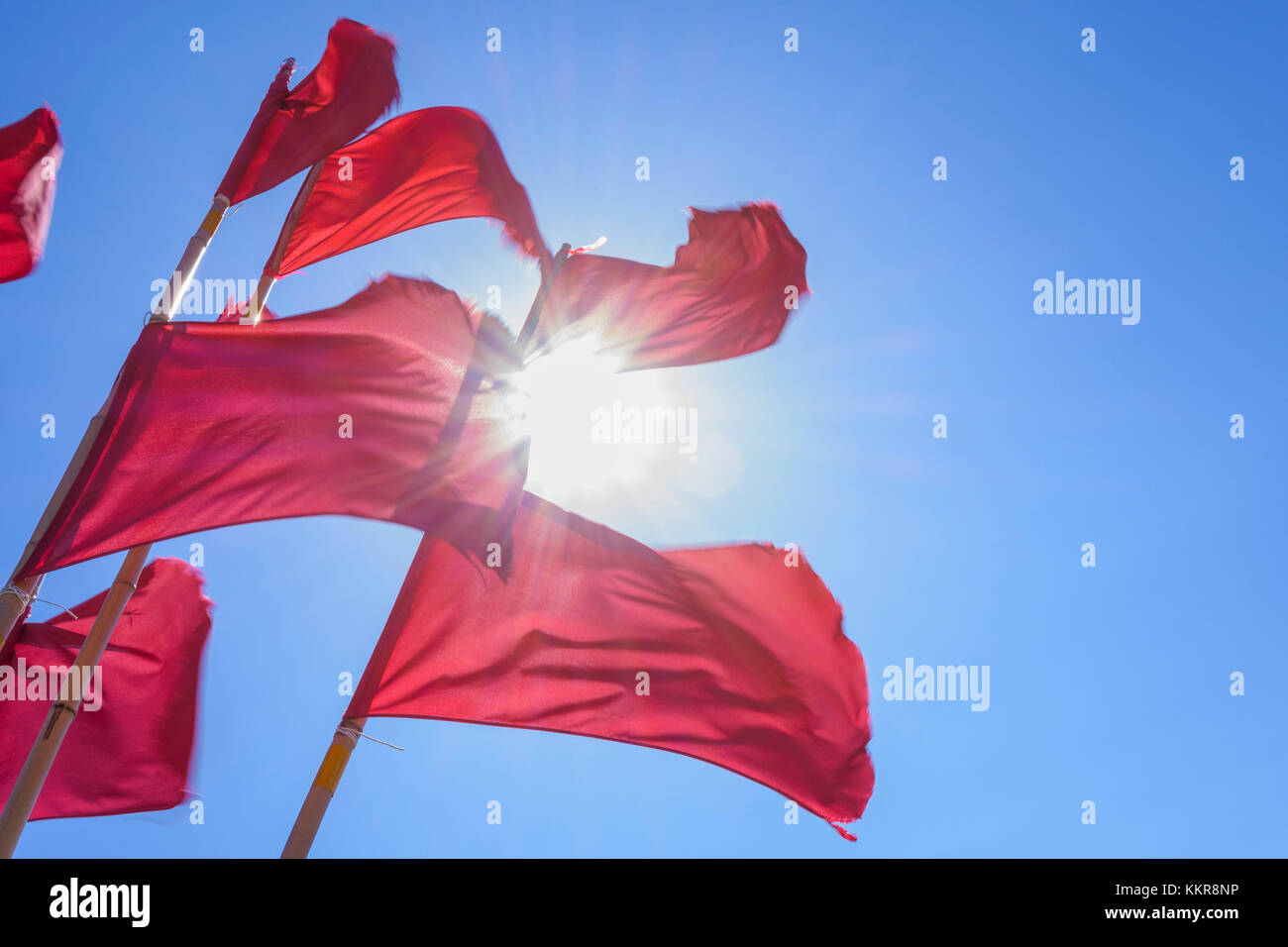 Red marking flags for fishingnets with sun, Hornbaek, Kattegat, Zealand, Denmark - Stock Image