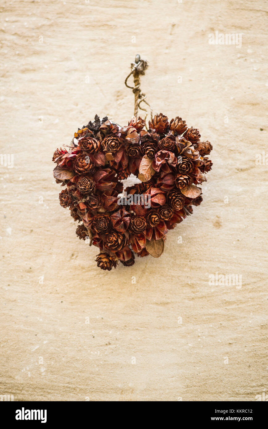 Austria, Lower Austria, Stein an der Donau, Christmas wreath of dried pinecones - Stock Image