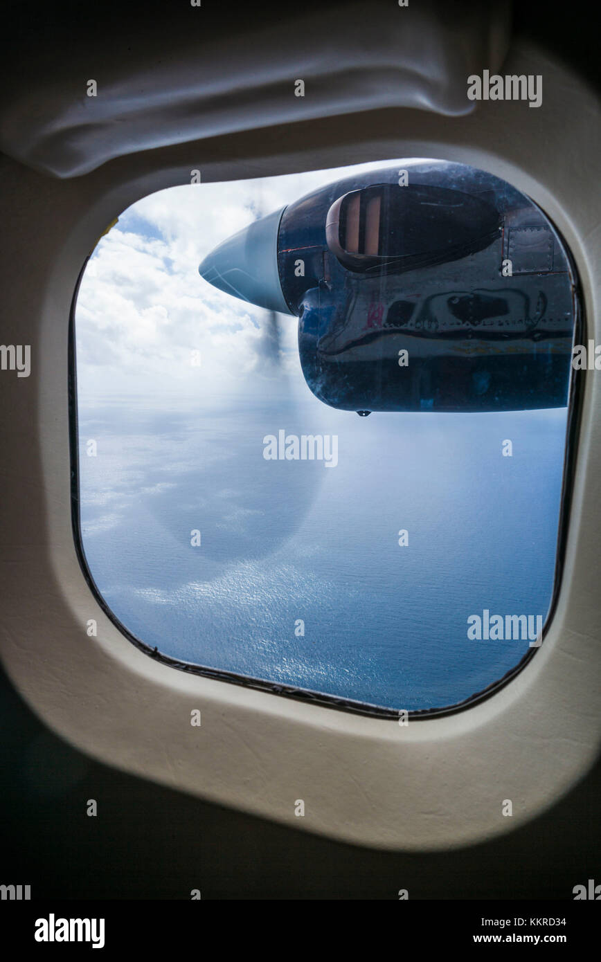 French West Indies, St-Martin, view through window of propellor-driven aircraft - Stock Image