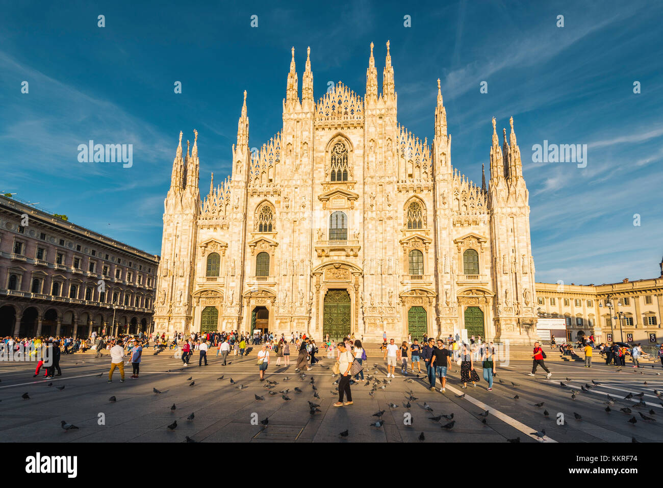 Milan, Lombardy, Italy. The facade of the Milan's Cathedral (Duomo) at sunset. - Stock Image