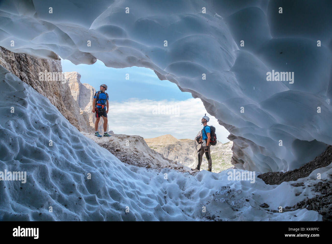 Italy, South Tyrol, Hochpustertal, Sexten. Snow cave in the summer season along the Alpinisteig / Strada degli alpini - Stock Image