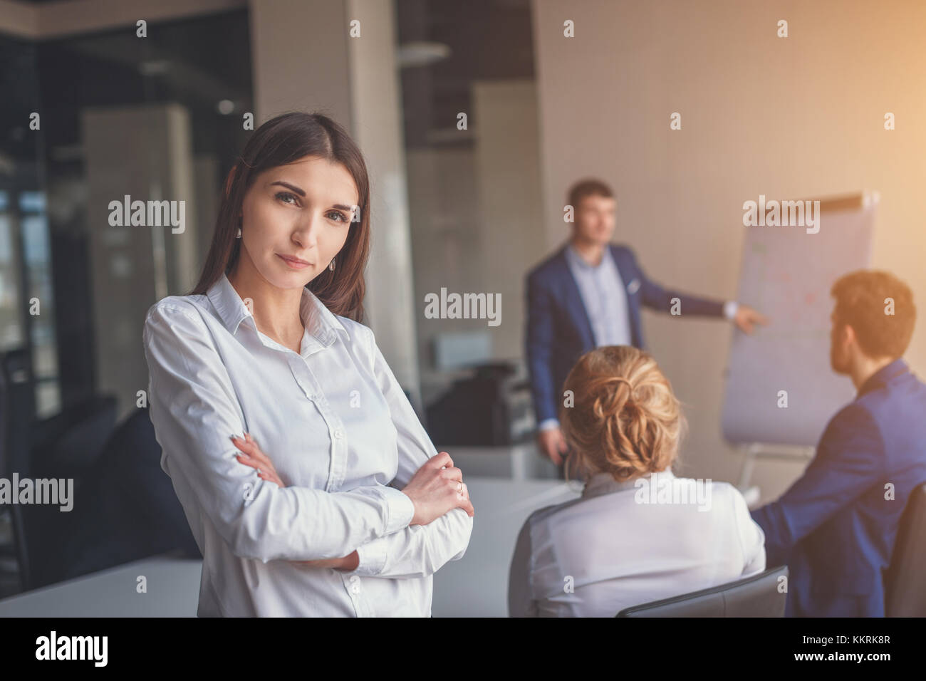 Modern business woman in the office with copy space - Stock Image
