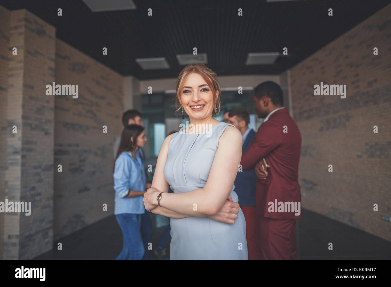 Business woman portrait . Crossed arms . - Stock Image