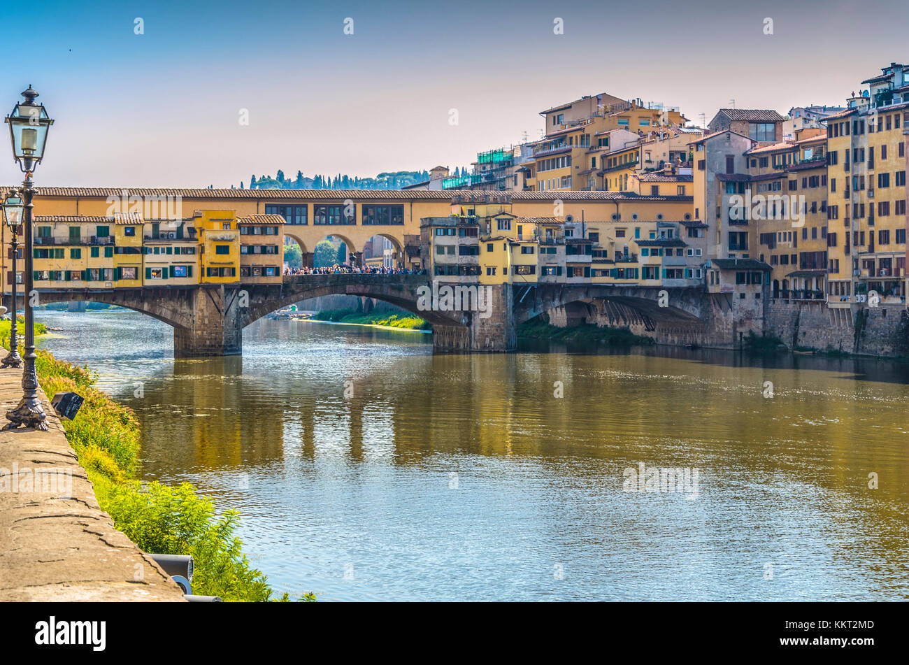 bank of  arno  river crossed by ponte vecchio in hours near the sunset - Stock Image