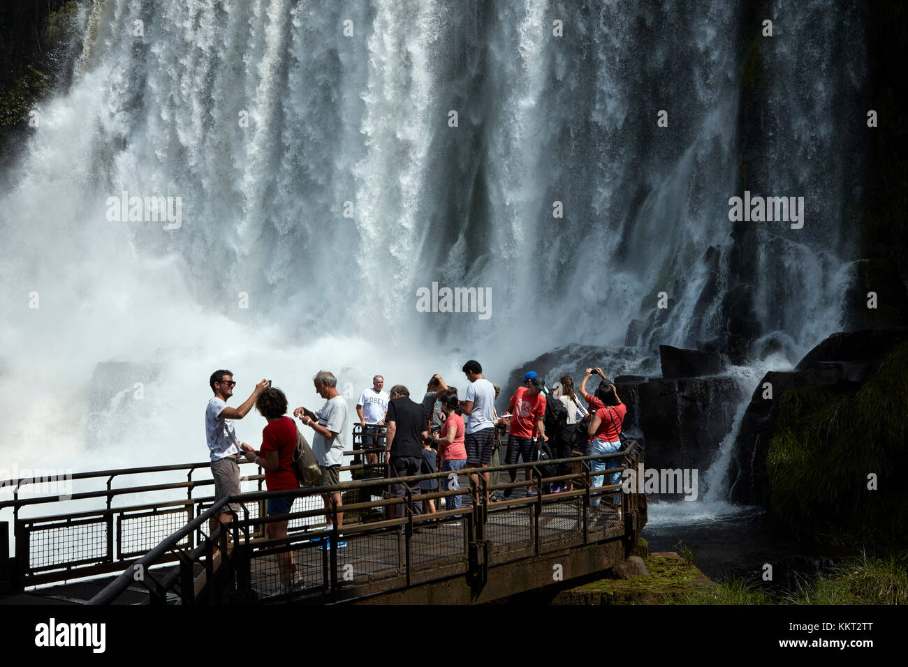 Tourists on lookout by Iguazu Falls, on Argentina - Brazil Border, South America - Stock Image