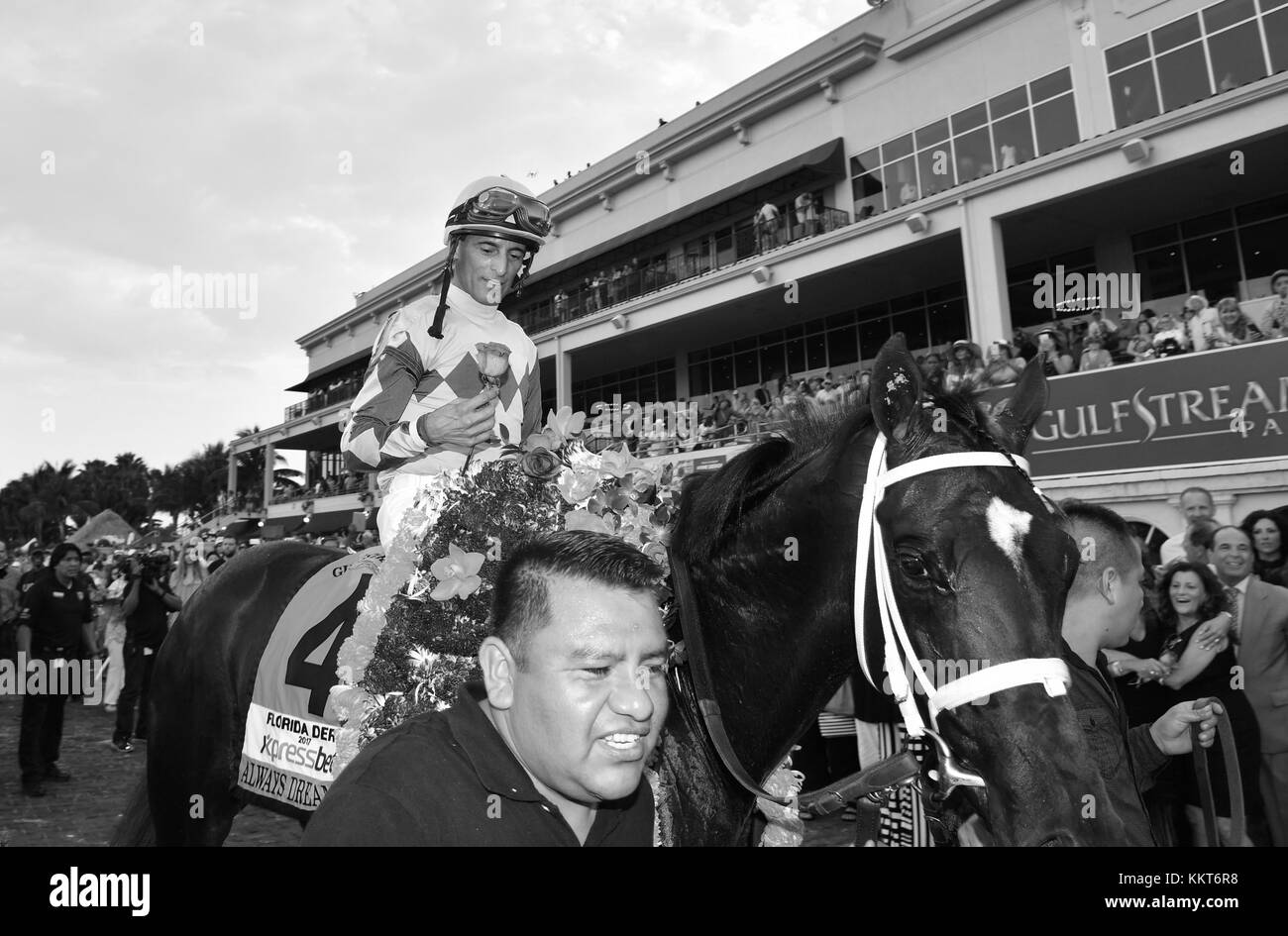 HALLANDALE, FL - APRIL 01: Always Dreaming (#4 ) gets a pat on the back before he crosses the finish line. Always - Stock Image