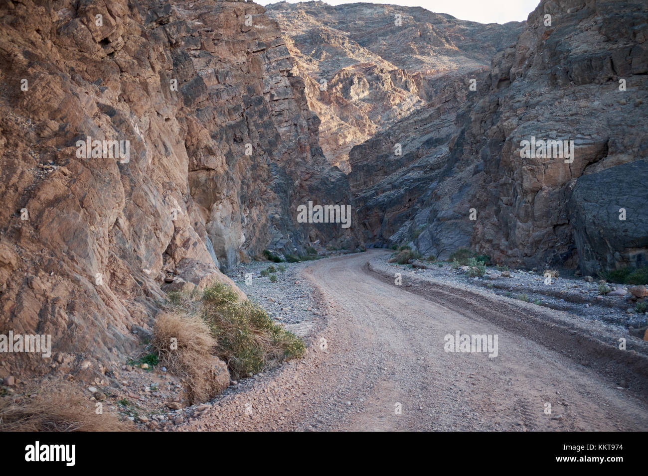 Winding road through a dry rugged rocky canyon in the Death valley National Park, Nevada, USA Stock Photo