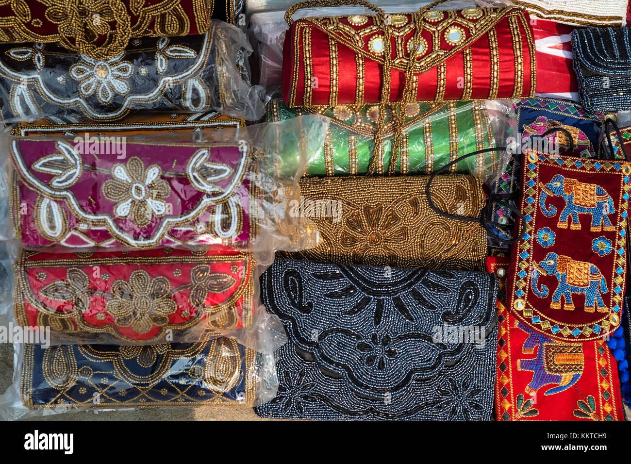 Range of colorful ethnic bags on Indian market - Stock Image