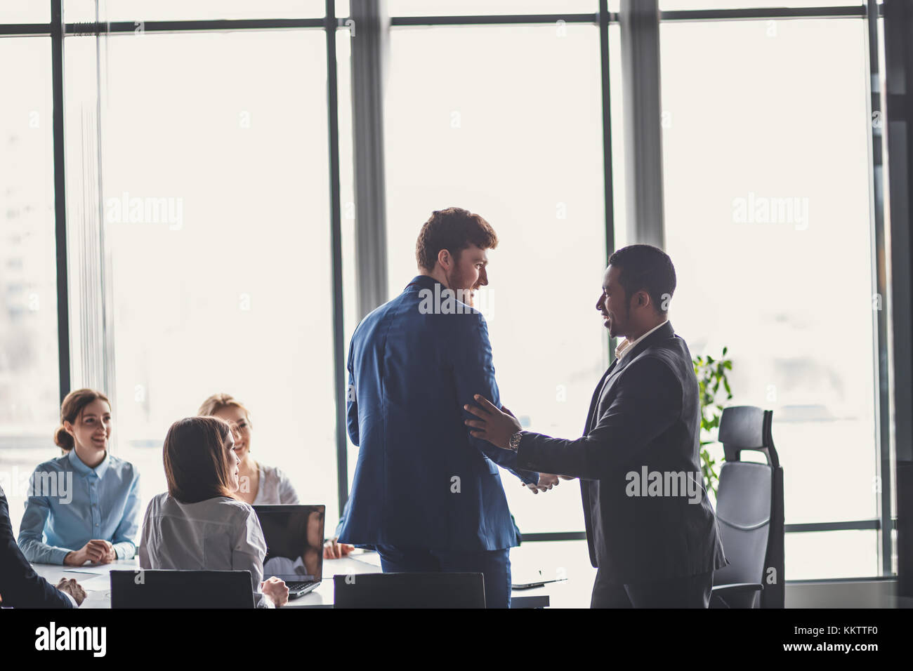 two business men shaking hands in meeting. great deal concept - Stock Image