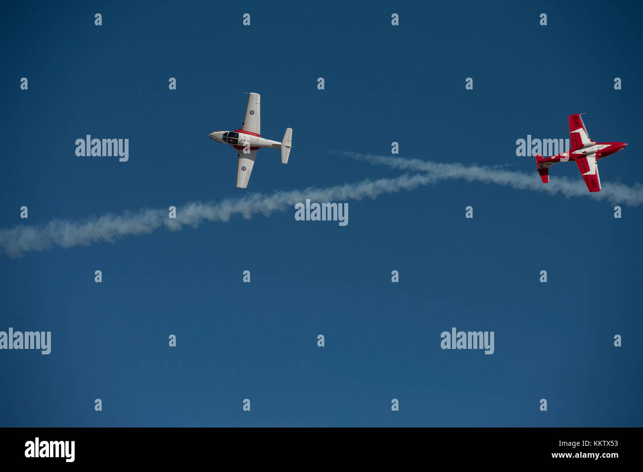 Royal Canadian Snowbirds performing an 'Inverted Opposing Knife Edge Pass at the 'Gowen Thunder 2017 Airshow' - Stock Image