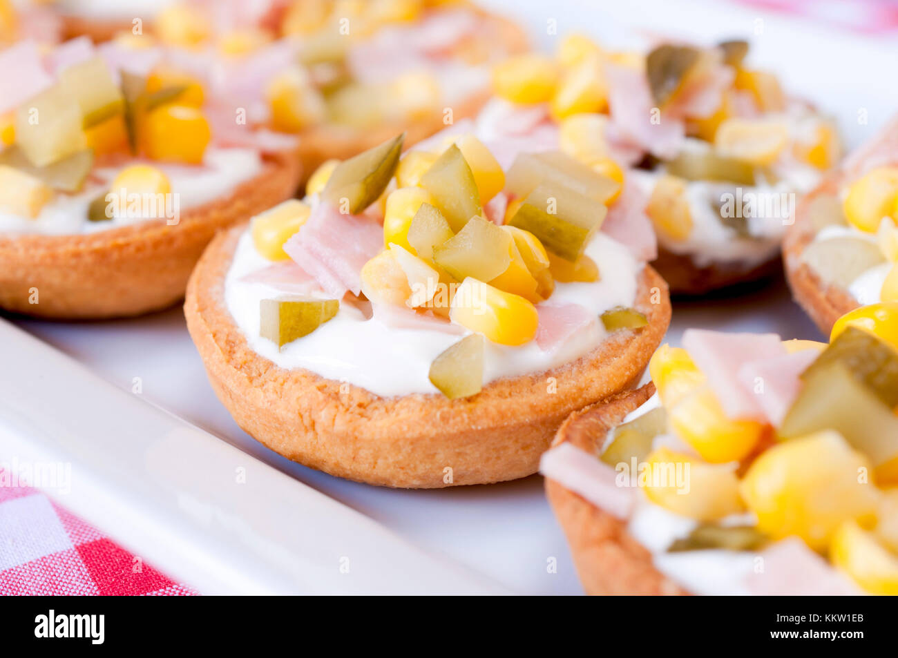 Selective focus on small appetizer in the middle - Stock Image