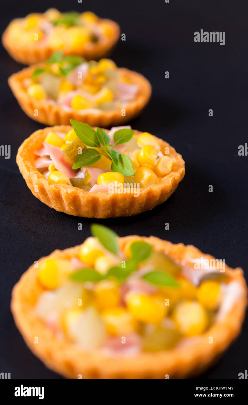 Selective focus on the second snack cup - Stock Image
