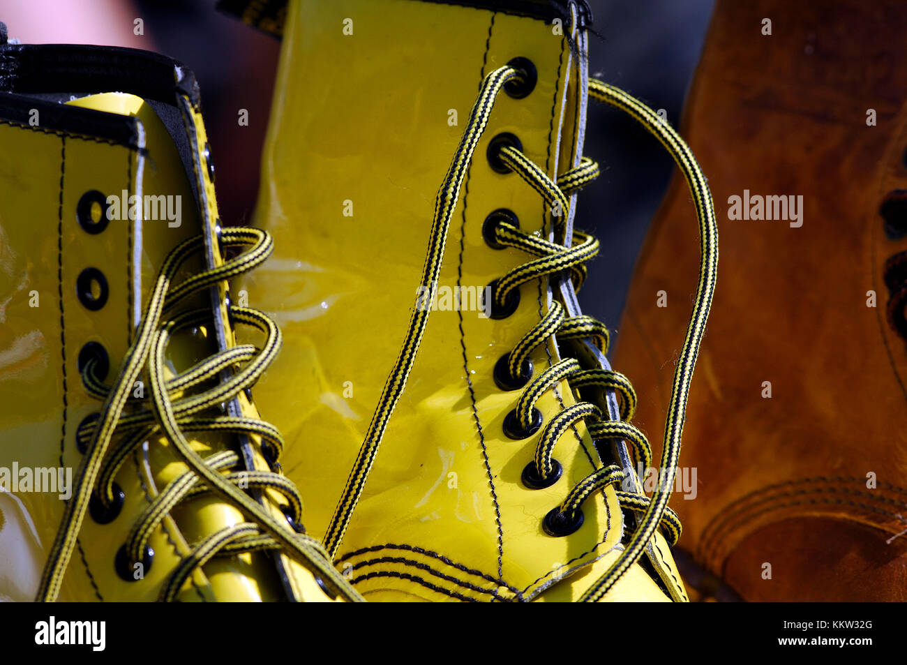 A pair of brightly coloured yellow doctor martens boots with high ankle support. Fashionable footwear for young Stock Photo