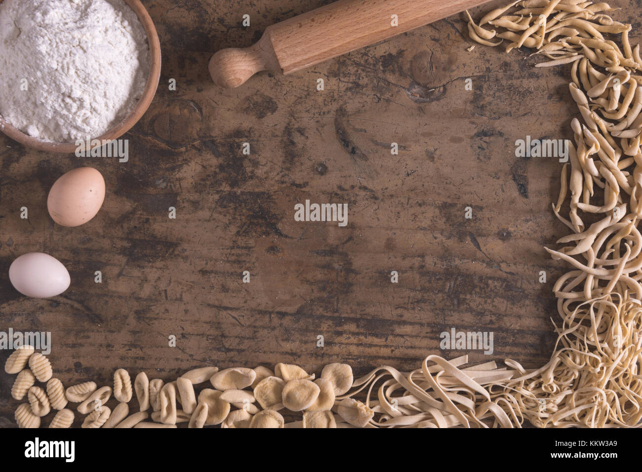 Mixed fresh italian pasta on wood table in  frame composition Stock Photo