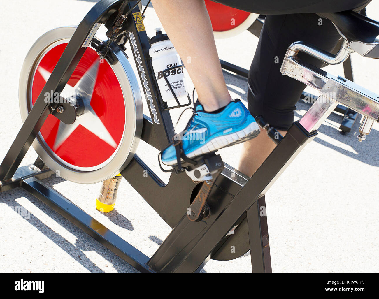 Legs moving during a workout of spinning -----Imperia, IM, Italy - May 18, 2014: People perform a spinning session - Stock Image